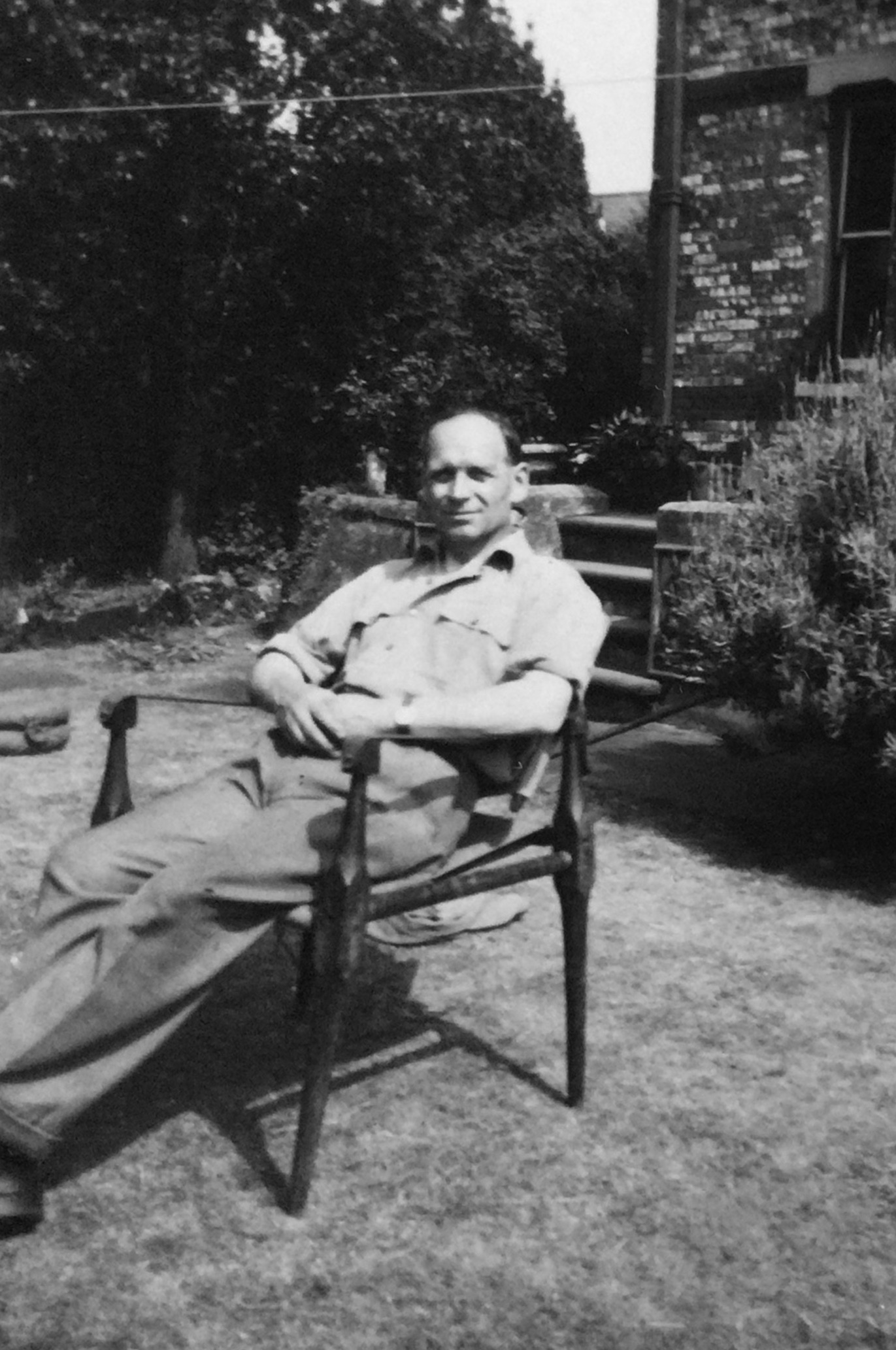 Leslie Amlot in his garden.