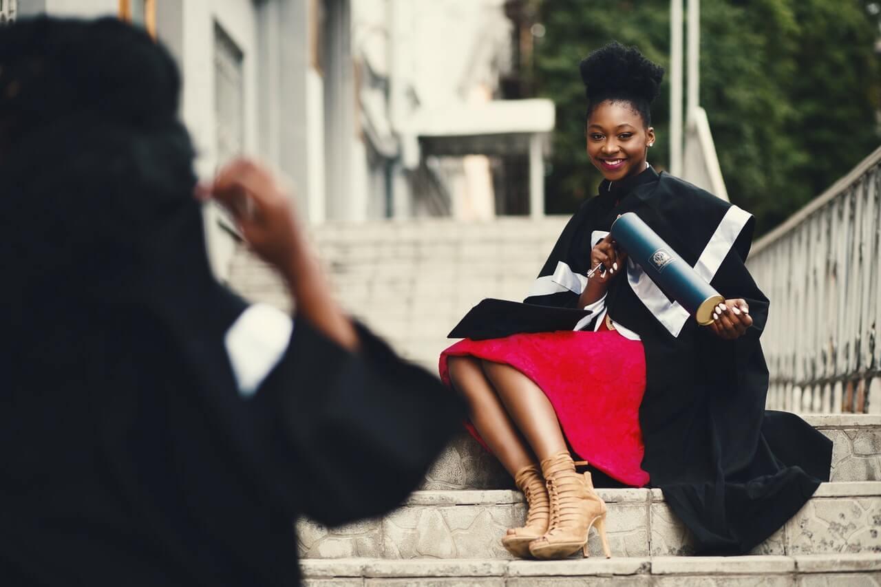 girl posting for graduation photo