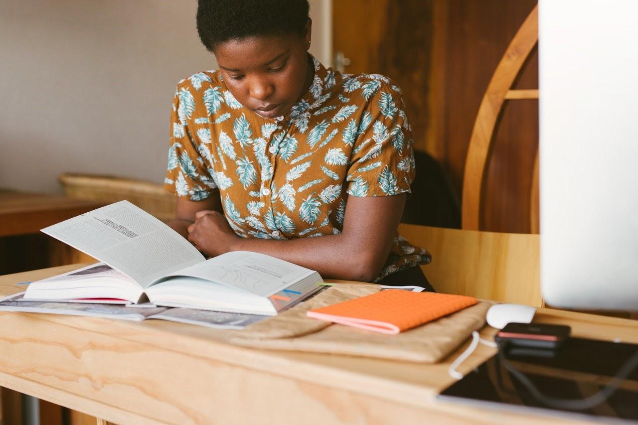 woman reading textbook