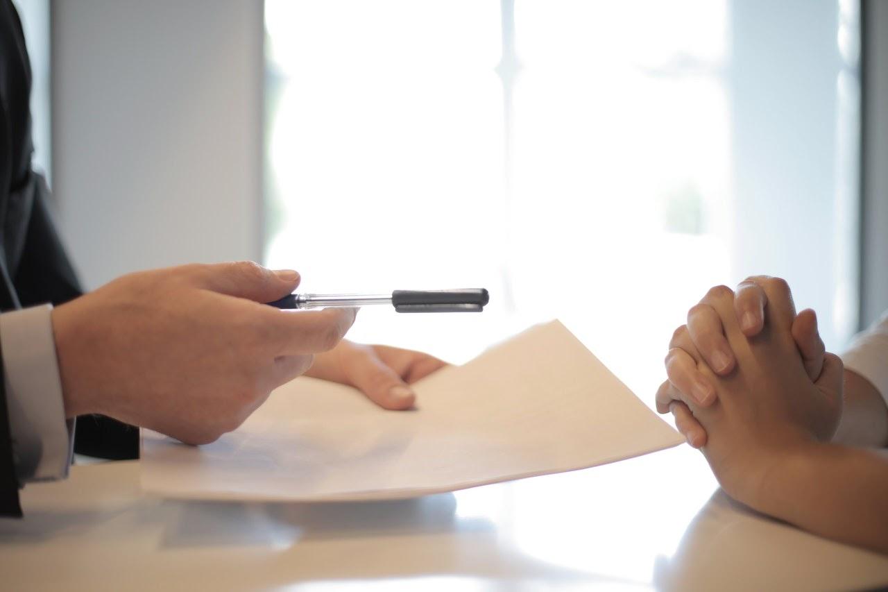 man handing over paperwork to client