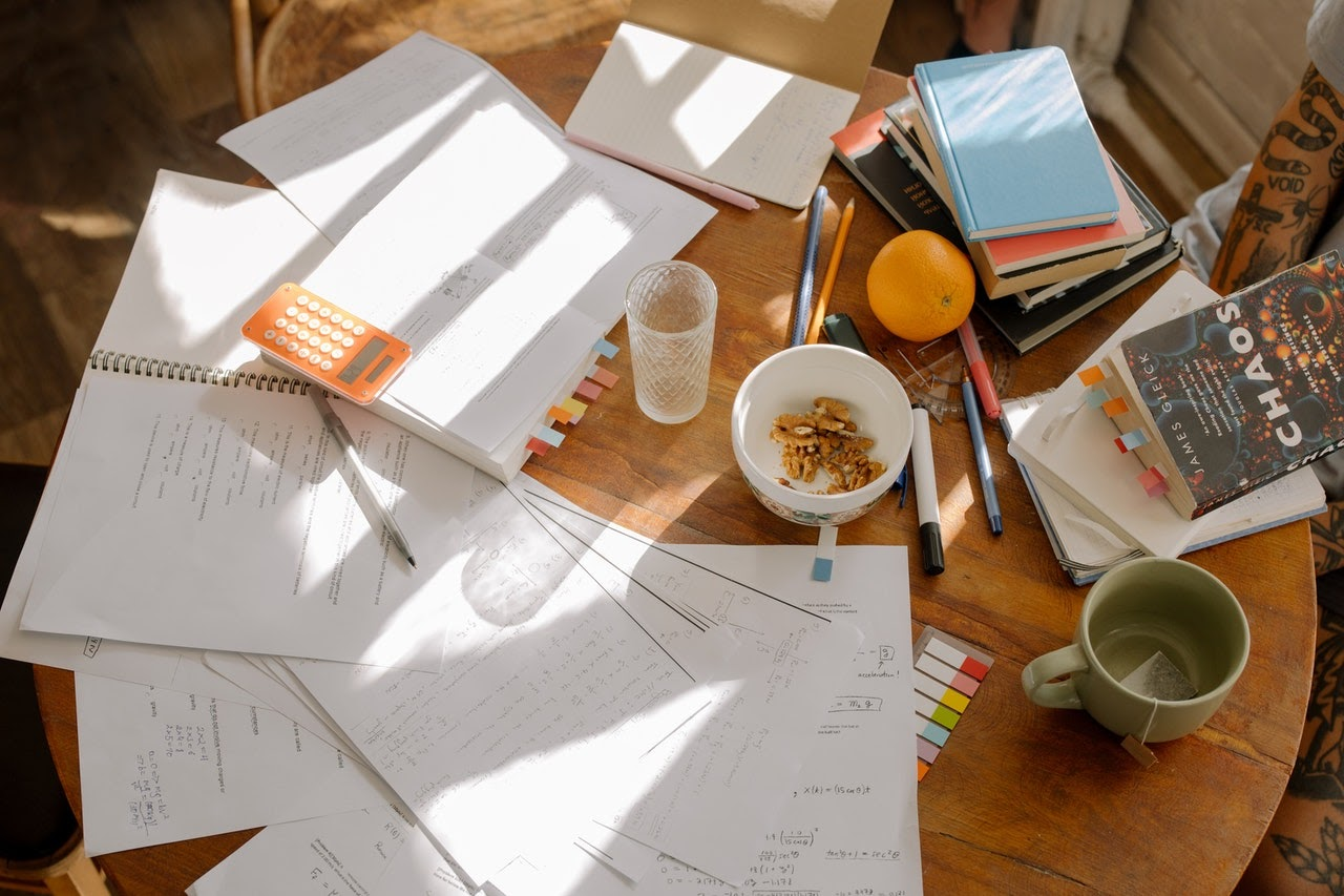 Papers scattered across table