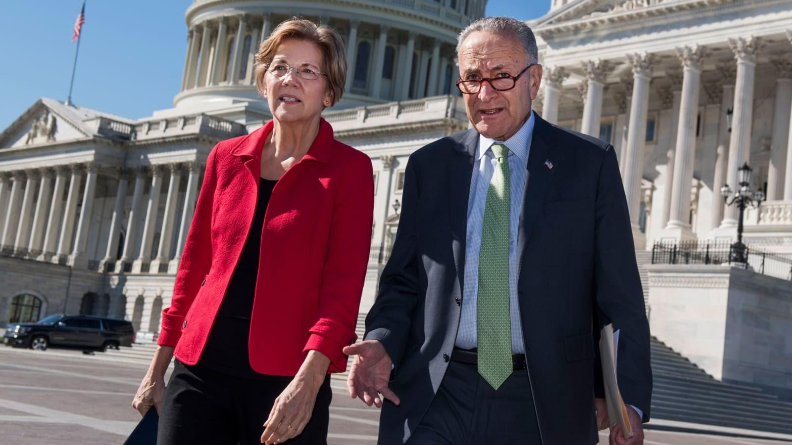 Elizabeth Warren and Chuck Schumer walking in front of Capitol building