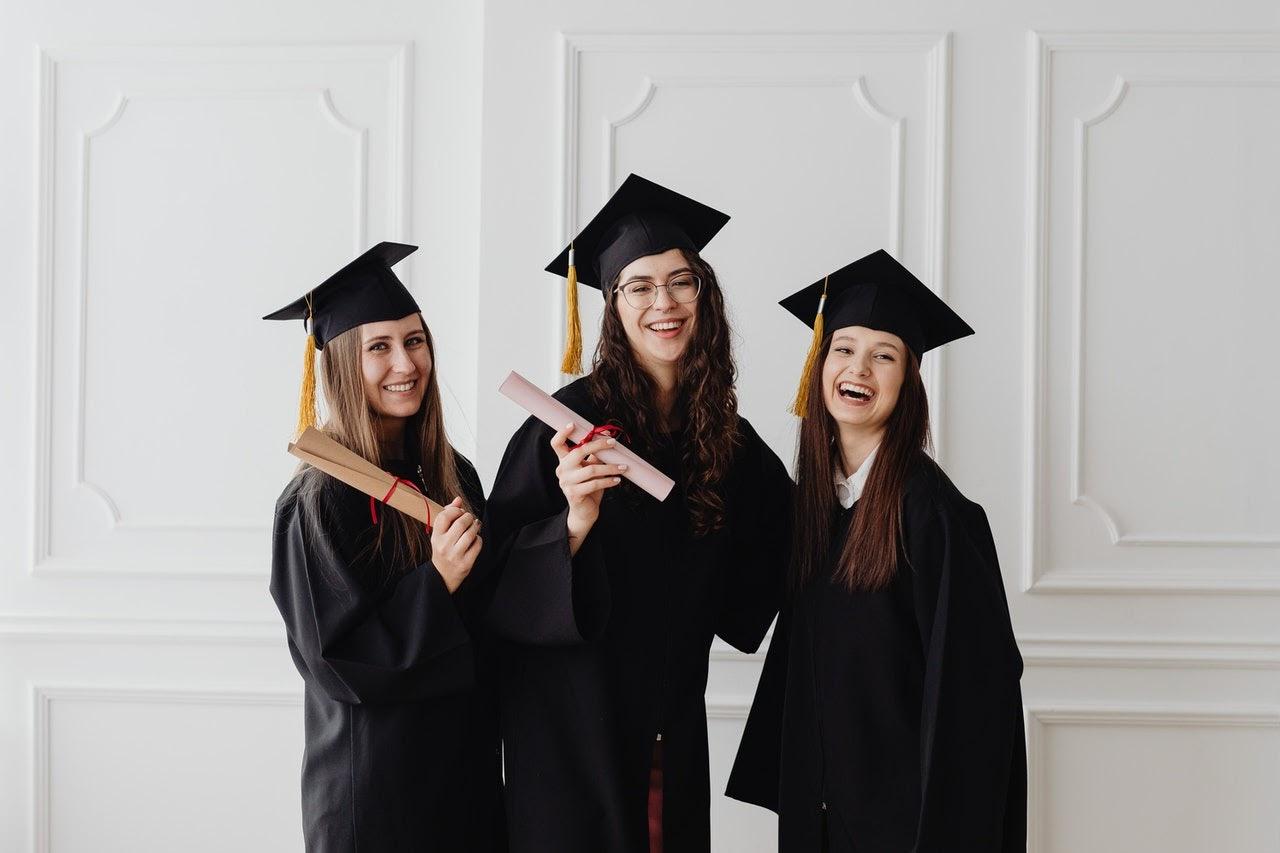 Three college graduates