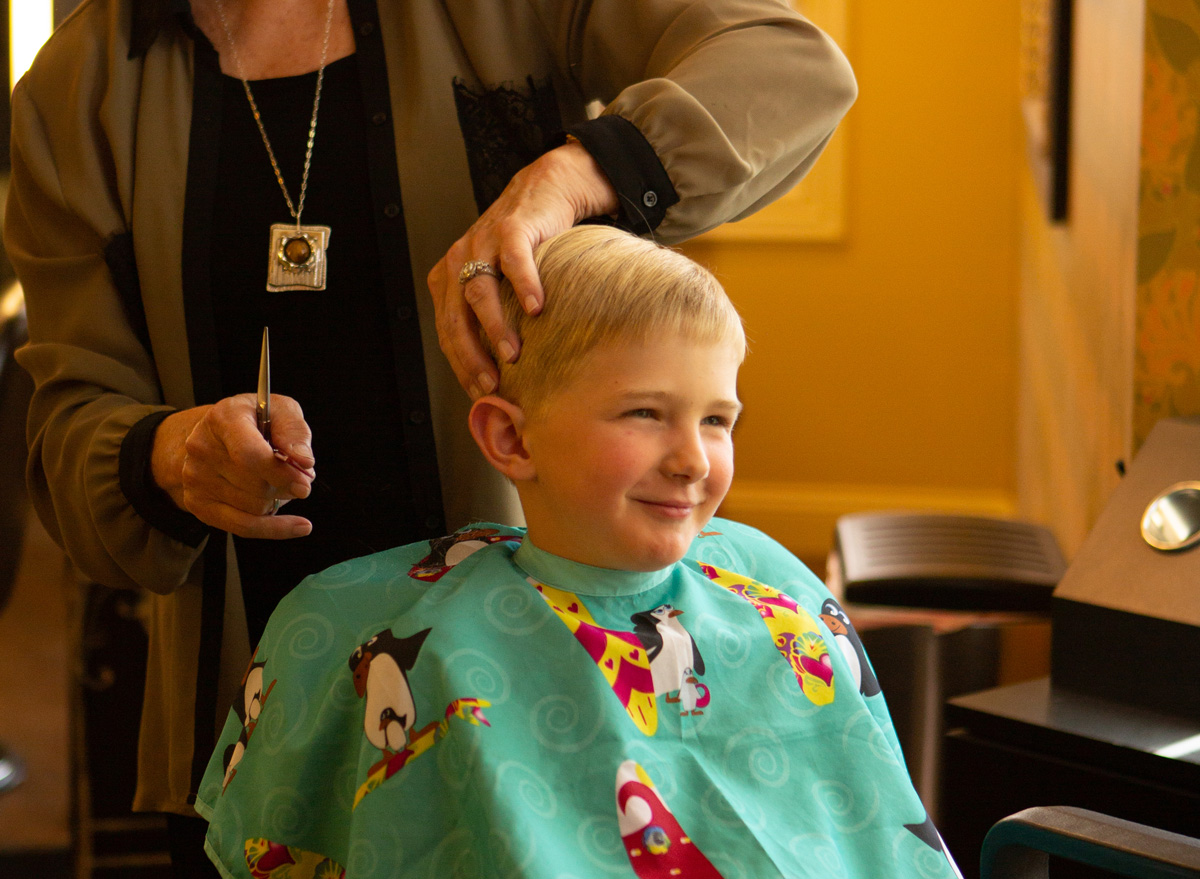 Boy getting haircut