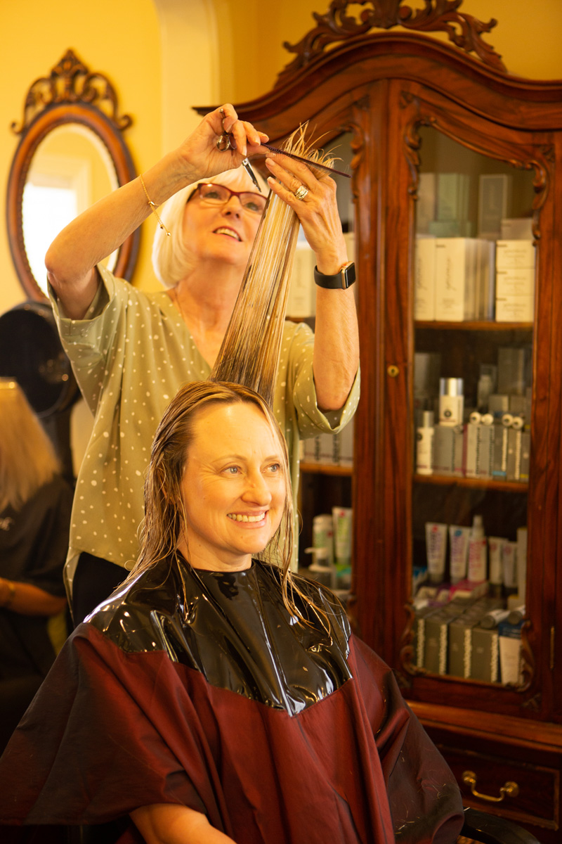 Woman with long hair getting trim