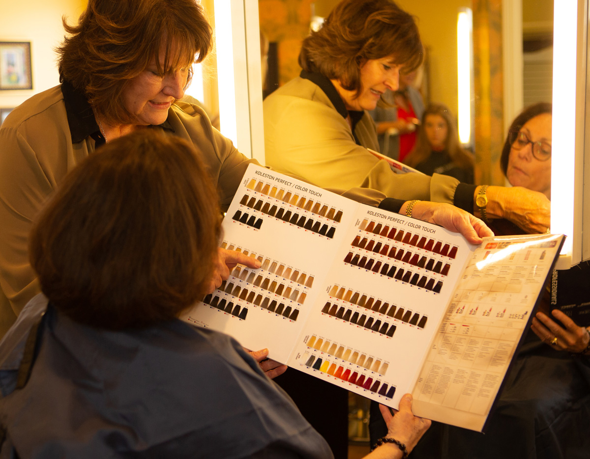 Women selecting hair color samples