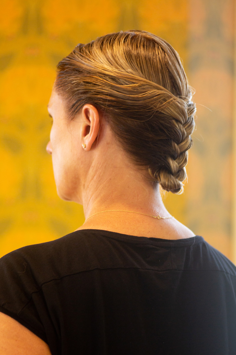 Back of woman's hair with braids