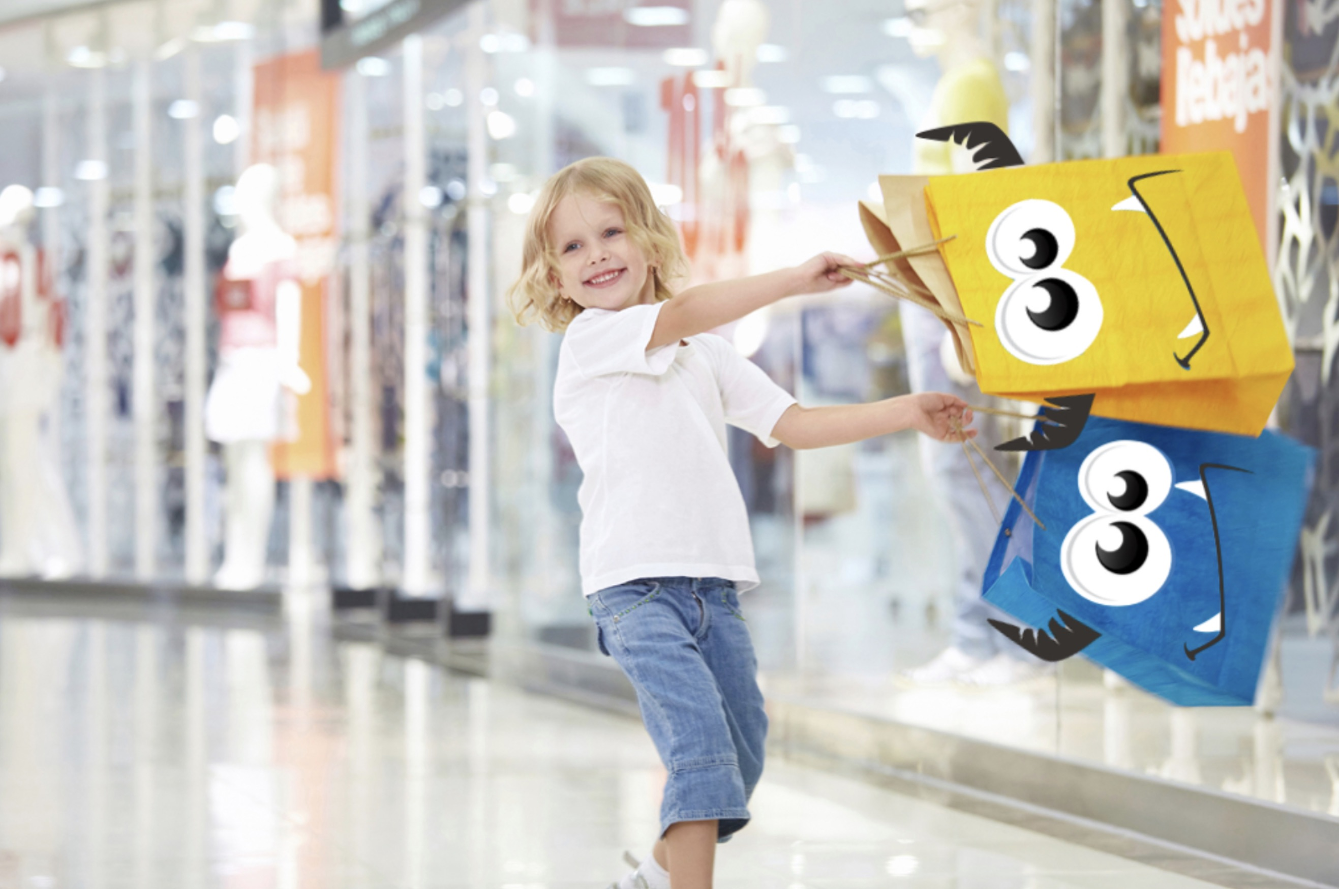boy happily holding retail monster shopping bags