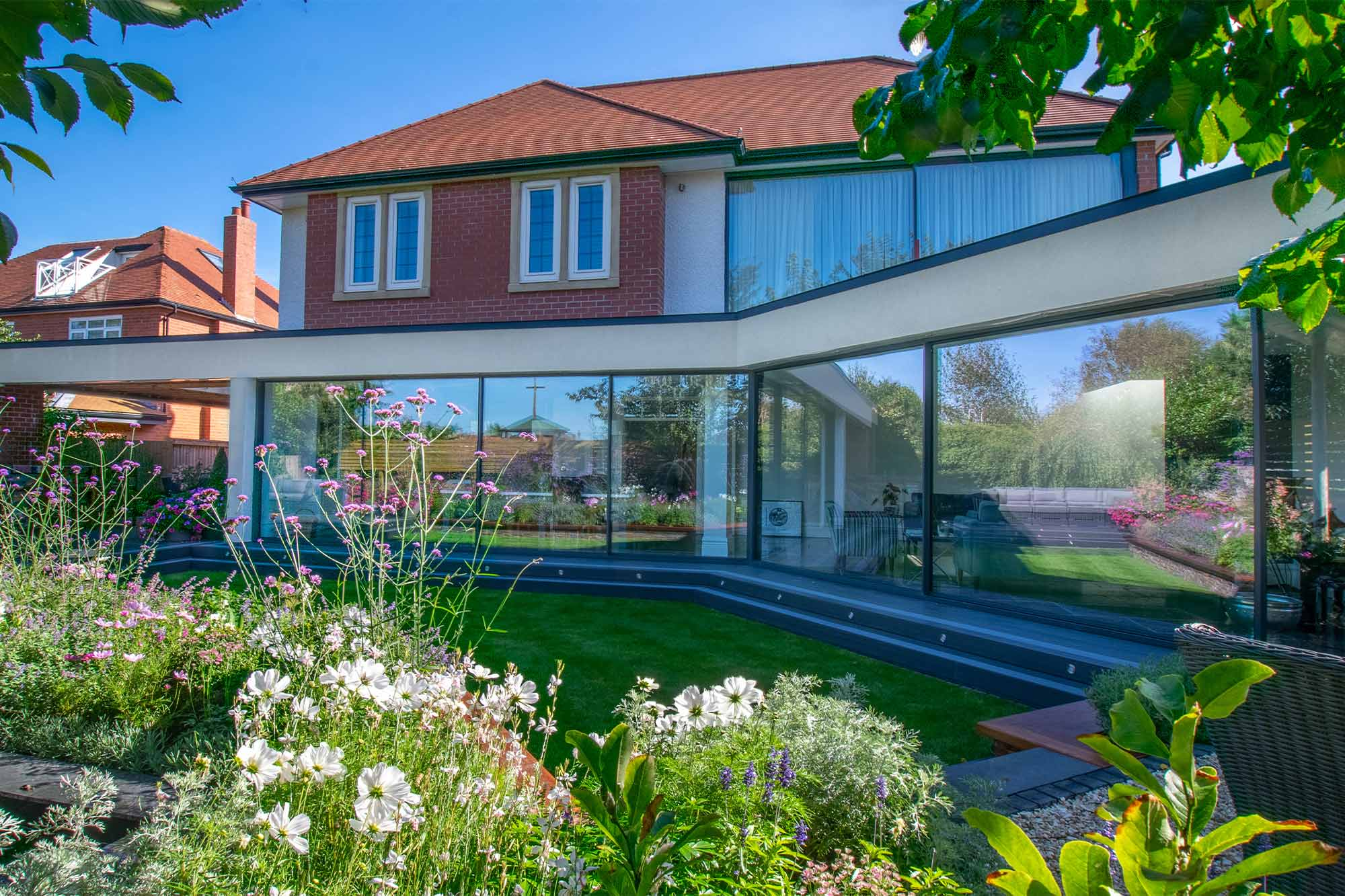 House re-model and contemporary extension architectural design featuring large sliding slimline glass doors in Lytham St'Annes, Lancashire