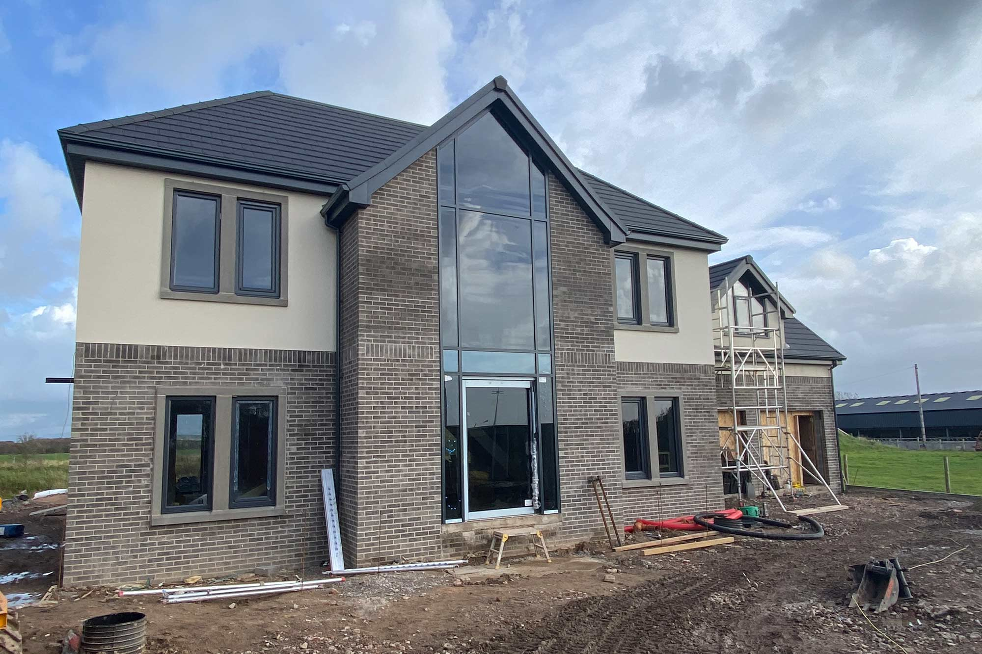 Bespoke, contemporary detached home with grand glazed feature entrance staircase architectural design in Blackpool