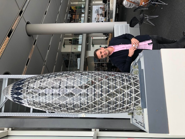 Picture of Thomas Zub at Foster & Partners HQ next to the Guirking Building model
