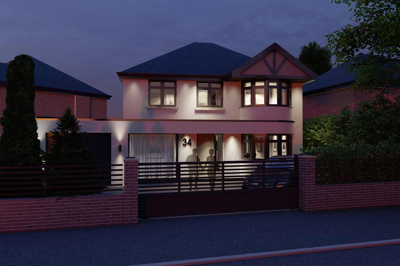 Contemporary front elevation of a detached house illuminated at night