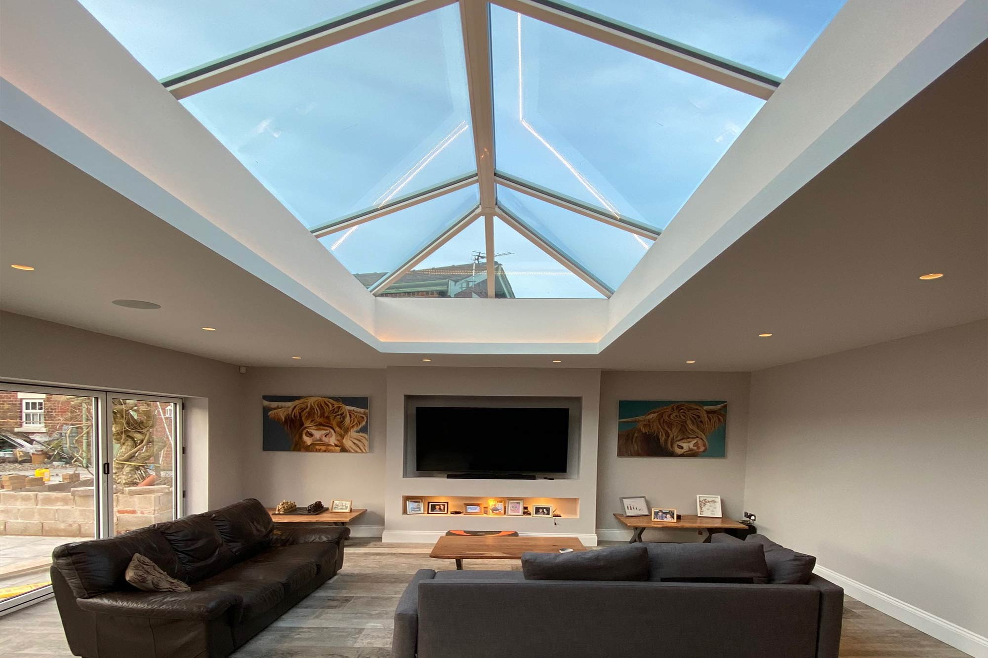 Interior of a large contemporary extension, featuring oversized lantern