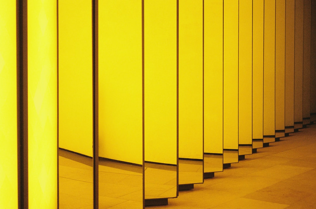 yellow wooden wall during daytime