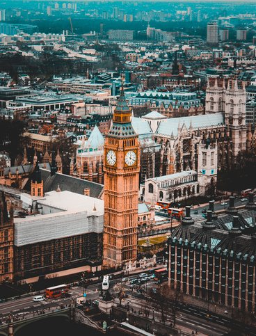 An aerial view of the city of London with the Big Ben at the centre.