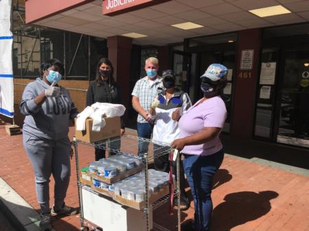 Councilmember Pinto helping to distribute food to Ward 2 seniors.