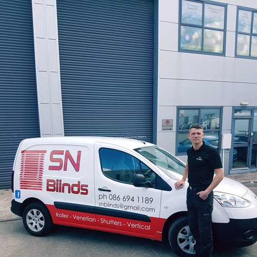 Owner Sam Nolan standing with one of the SN Blinds fleet vans