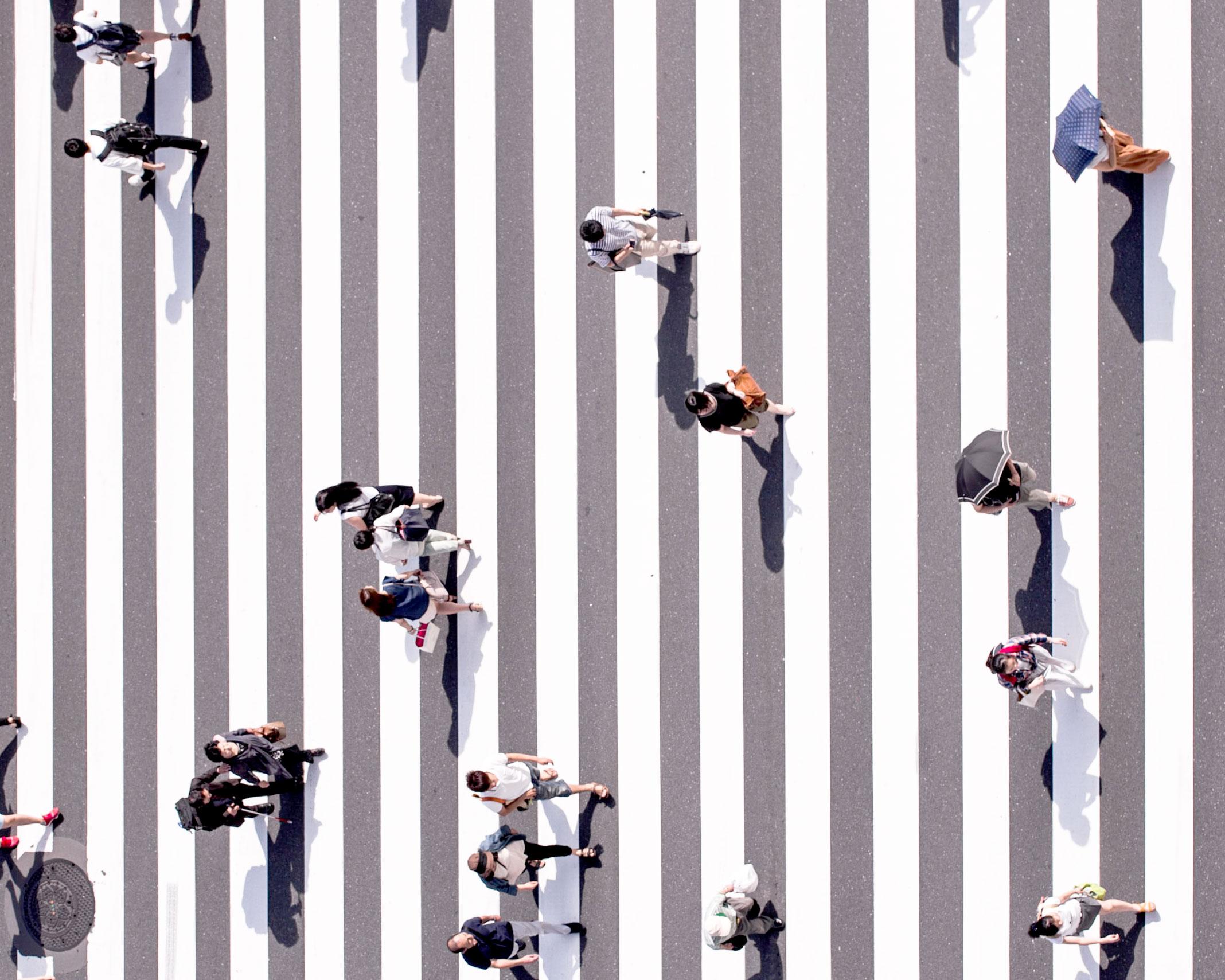 people-walking-over-street-crossing