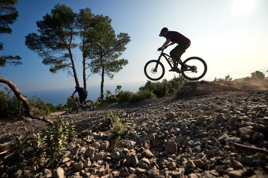 Mountain biking in a beautiful sunset in Finale Ligure in Italy