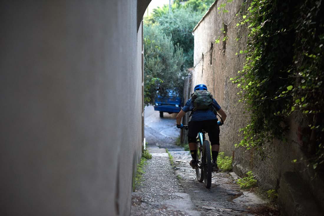 exploring the city of Varegotti on a mountain bike