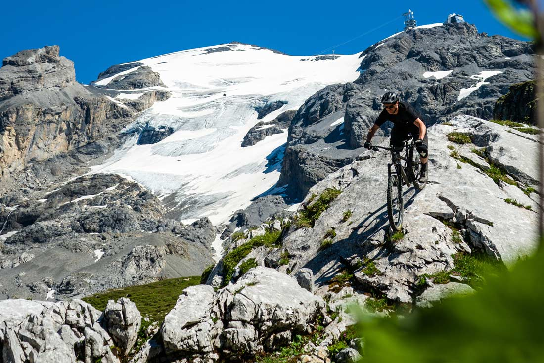 Mountain biking in front of Titlis, Engelberg