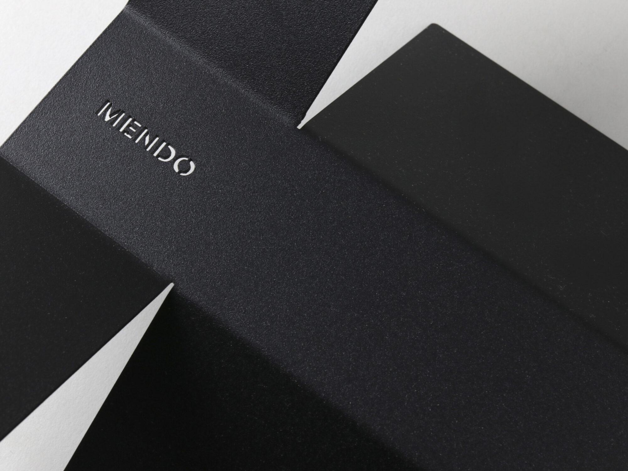 Mendo bookstand detail with logo.