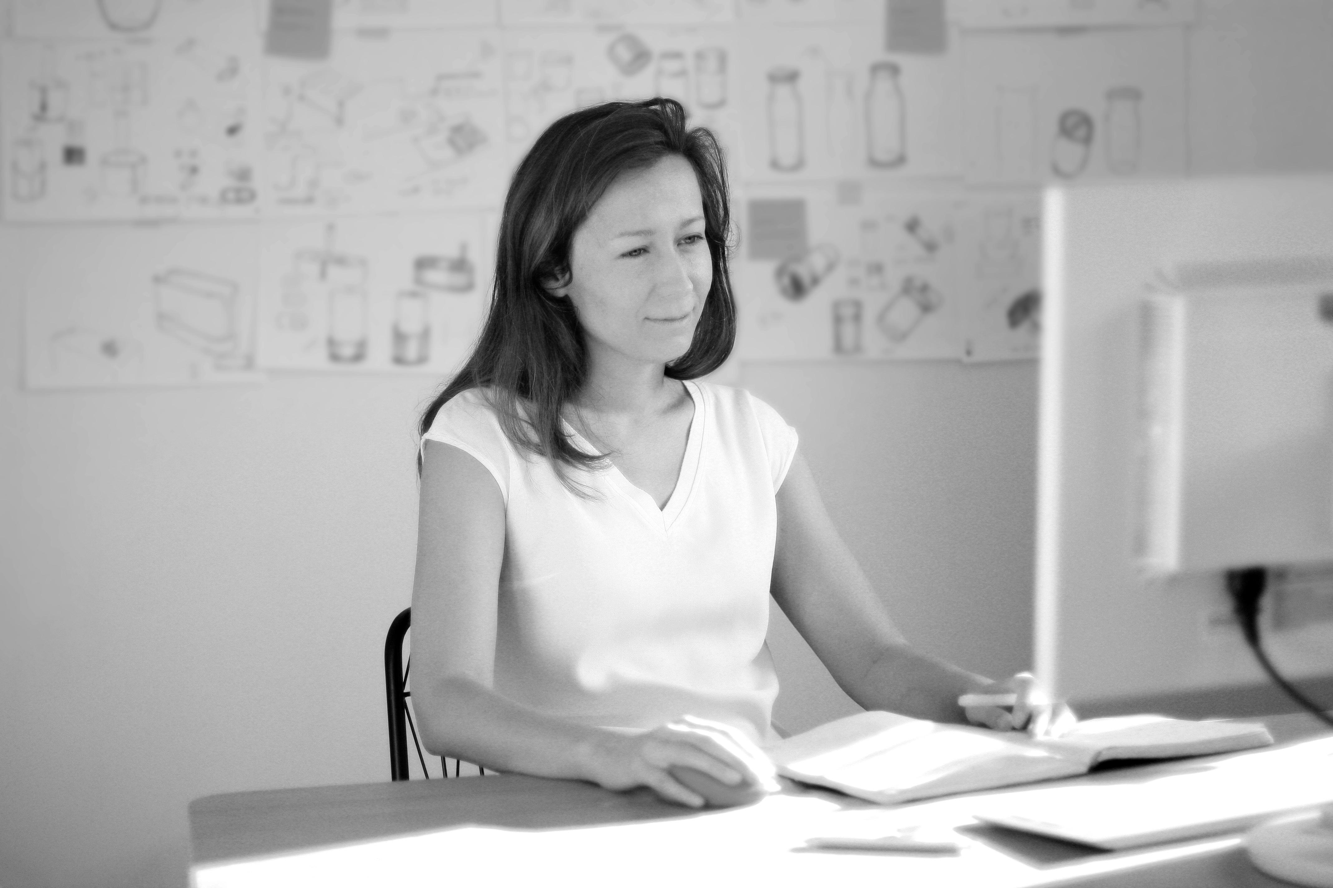 Gabi Potsa designer and owner of Entrive in front of sketches
