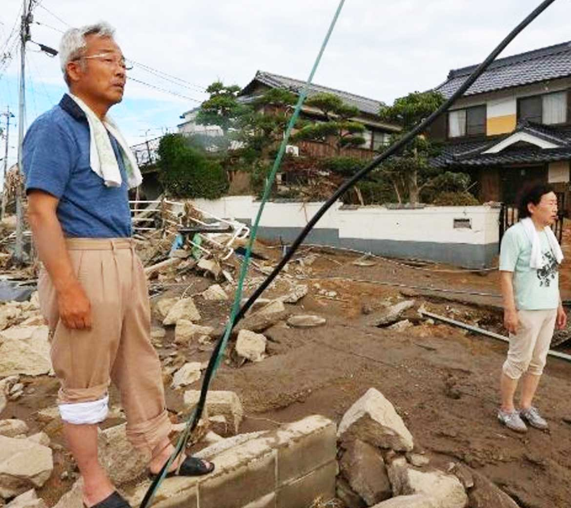 Family in Japan surveying their property after the flood in Japan.