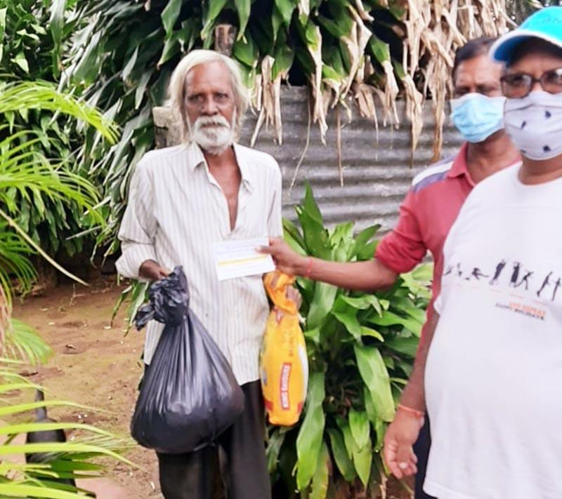 Staff handing food to a man in Mauritius