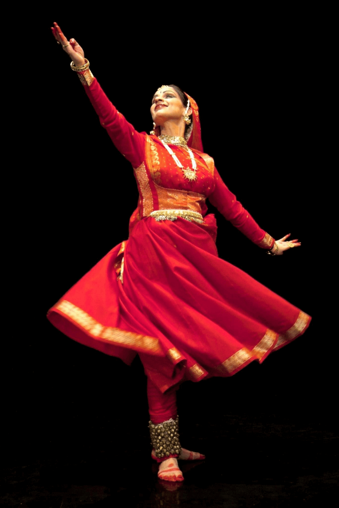 A woman in a Kathak pose.