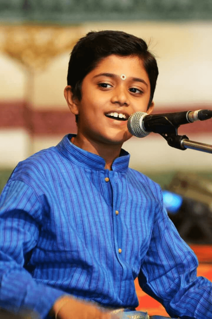 Boy singing Classical Indian Music.