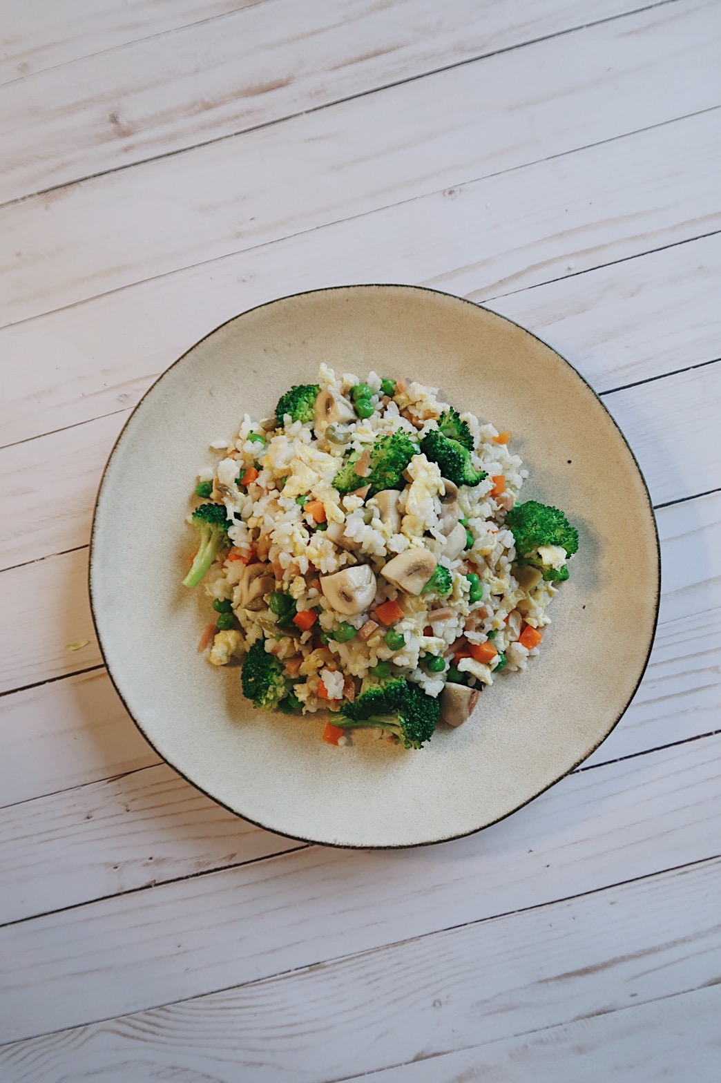 A plate with veggie fried rice