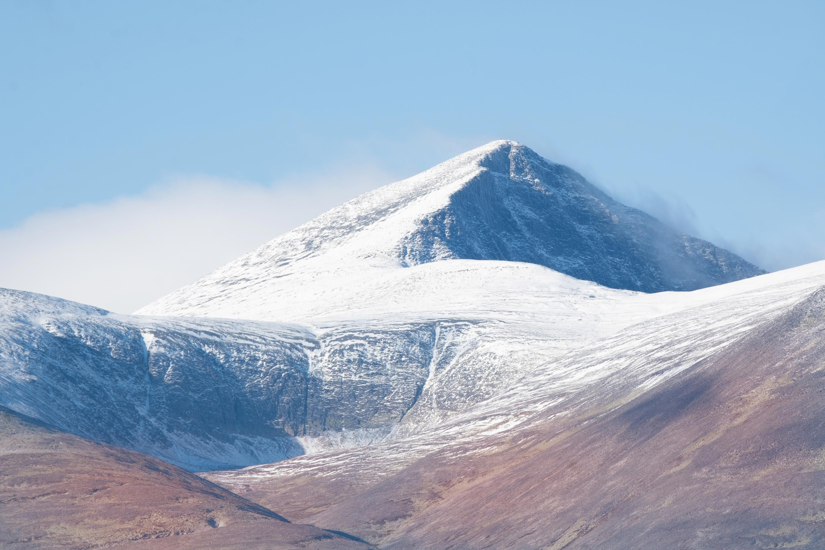 Majestic Norwegian mountain summit on a clear, blue day