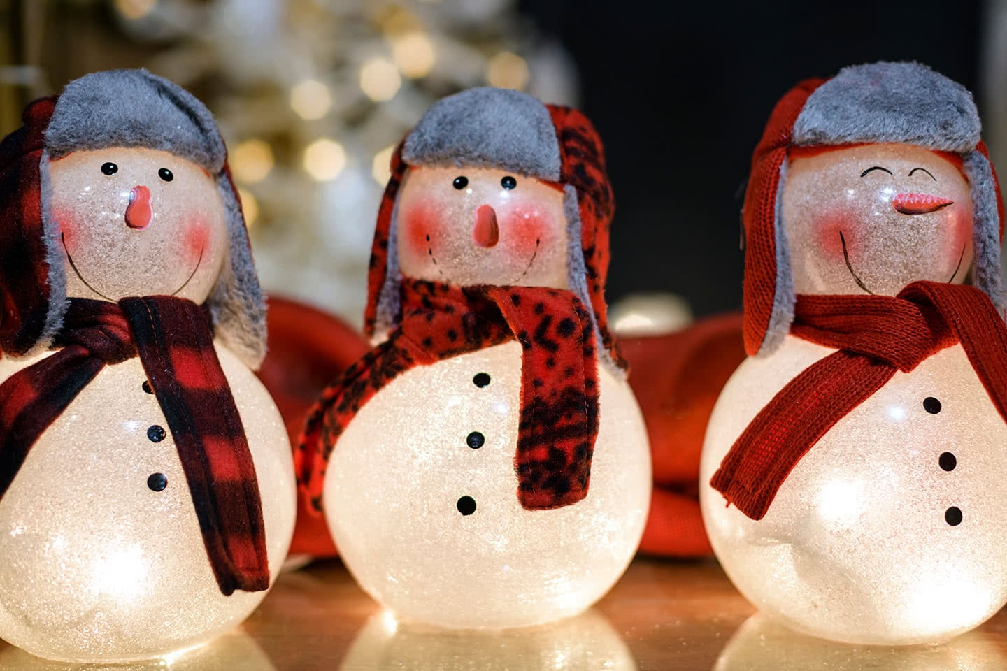 Three Lighted Snowmen wearing Hats and Scarves
