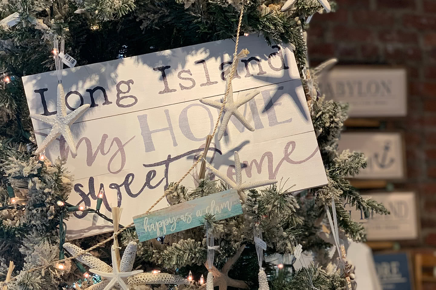 Long Island My Home Sweet Home Holiday Sign and Starfish Ornaments on a Christmas Tree
