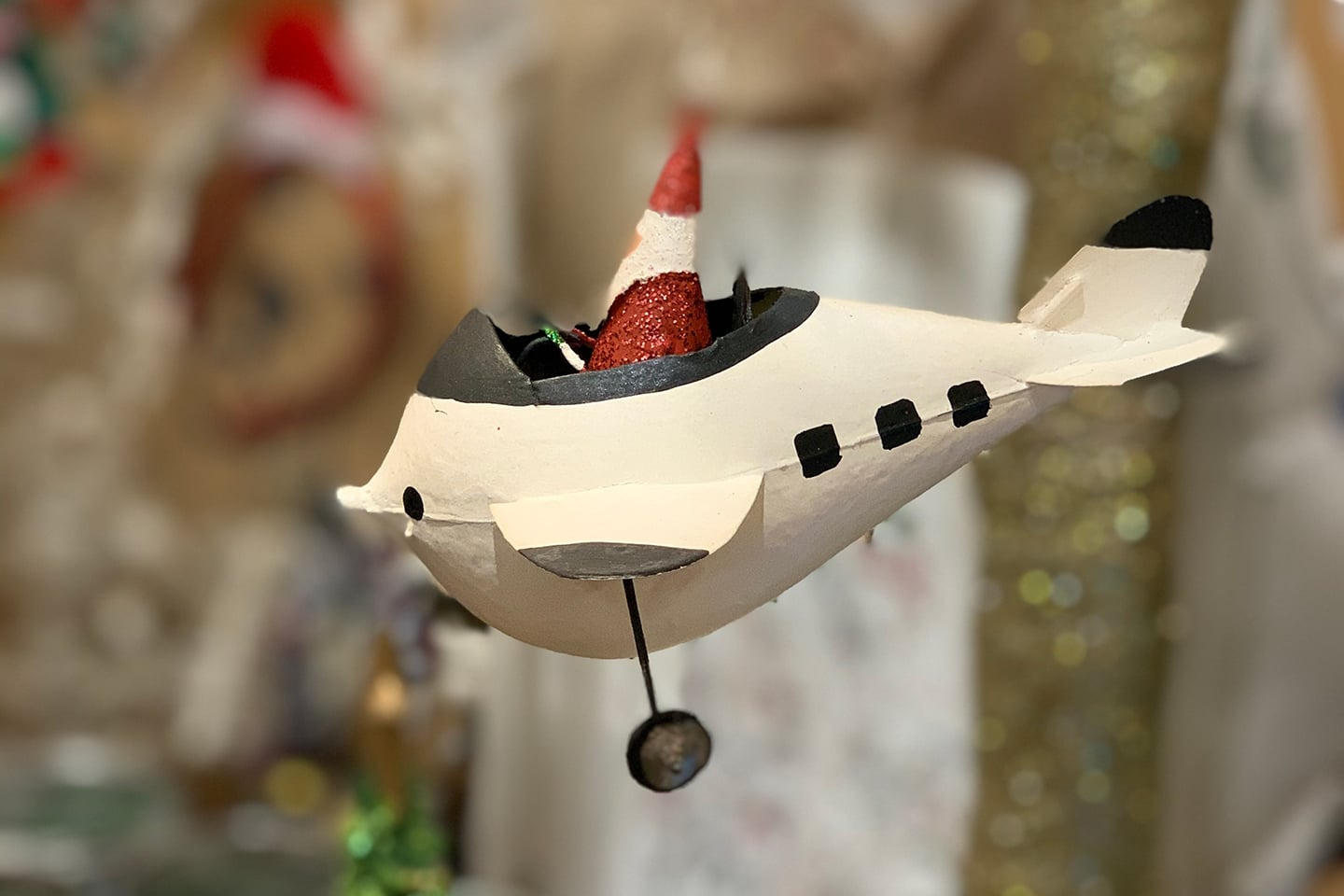 Santa is flying from the North Pole in his Airplane Ornament