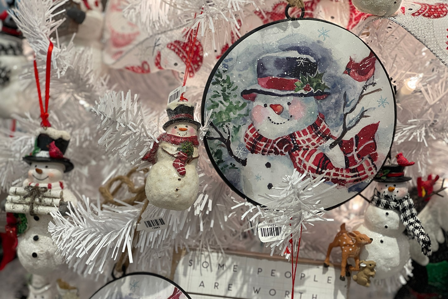 Snowman Ornaments on Frosted Christmas Tree