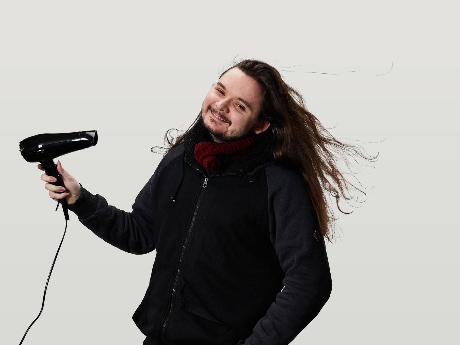 Calin blow drying his long hair