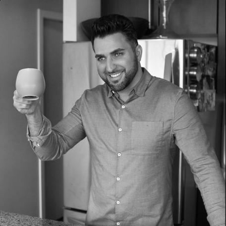 Founder Kayvon bust shot with coffee mug photo