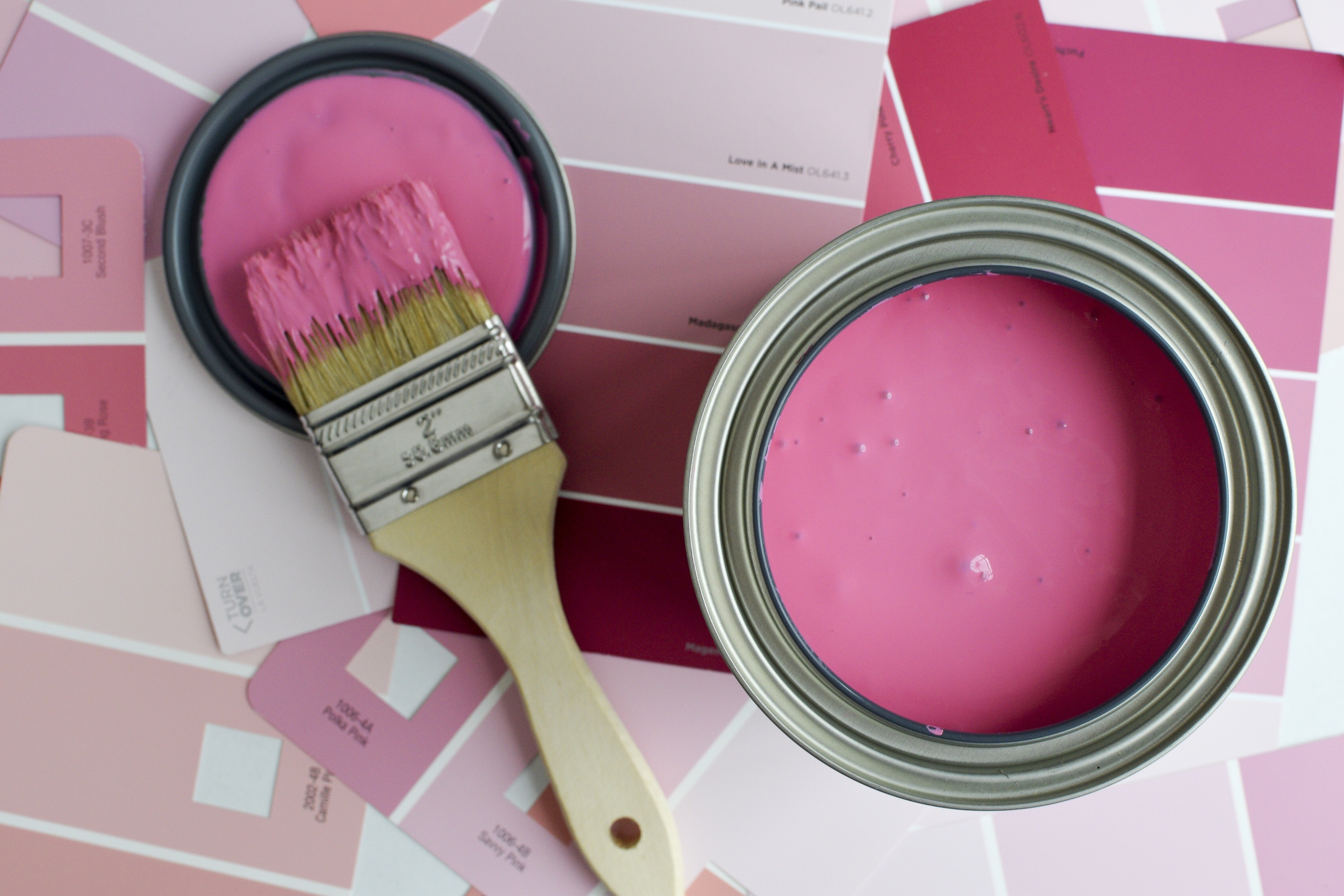 Image of paint can and paint brush.