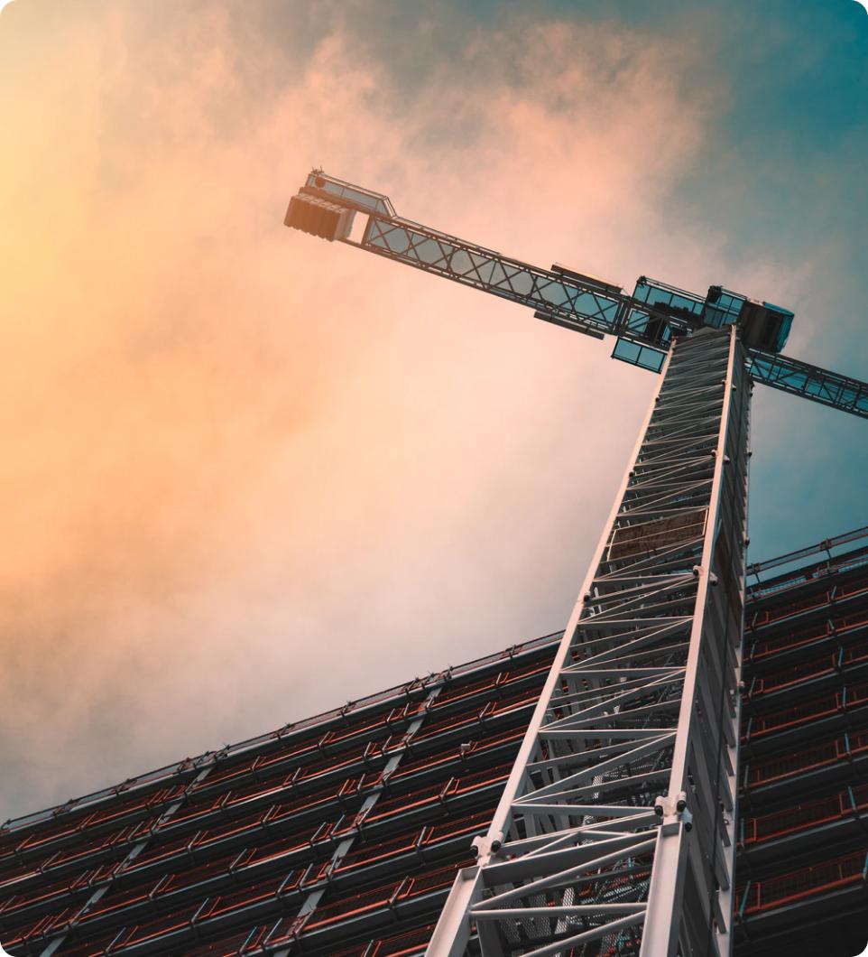 A crane rising up towards the sky