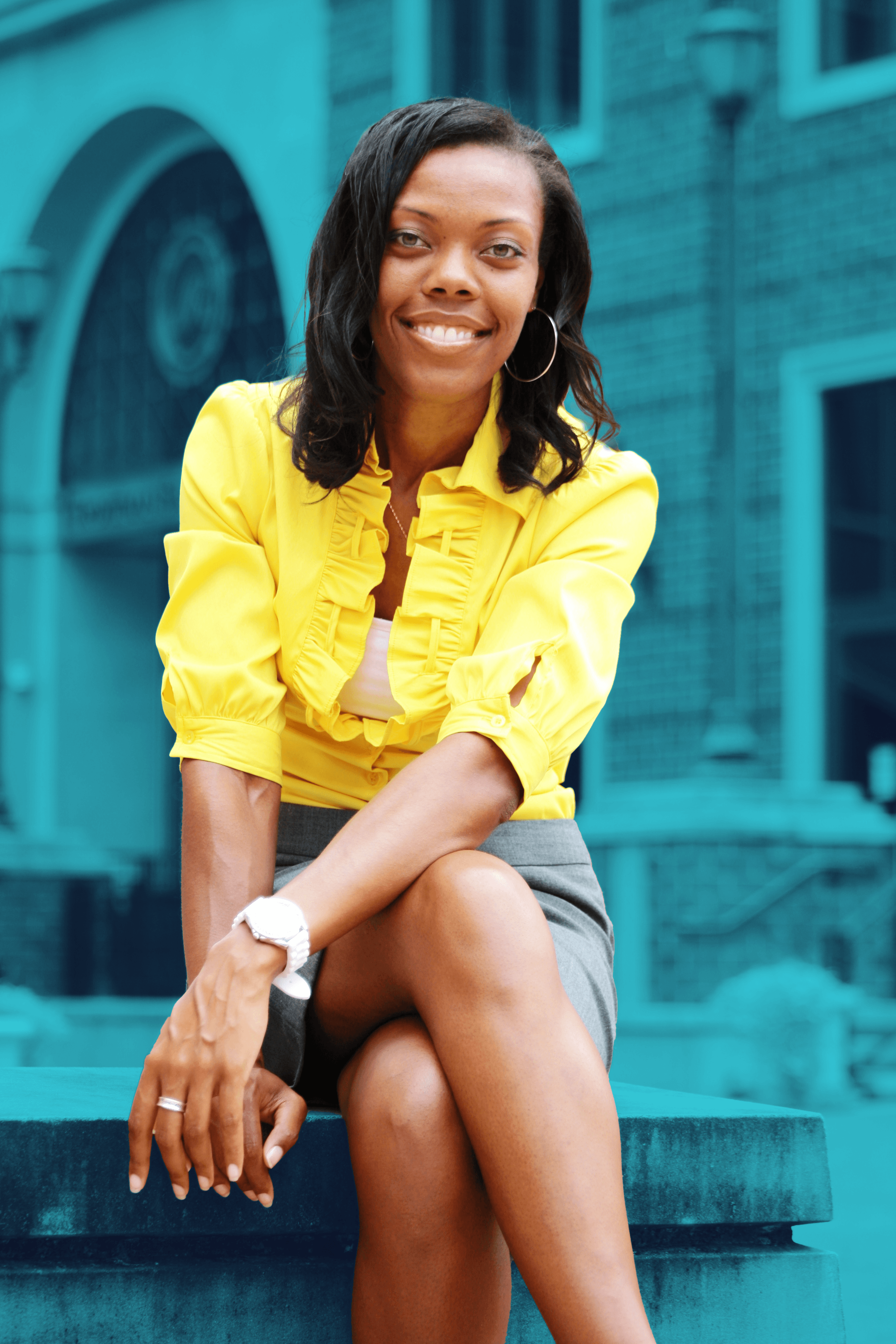 Arianne Mockabee wearing a Yellow Blouse with Gray Pencil Skirt sitting on a Bench in Downtown Richmond, Virginia