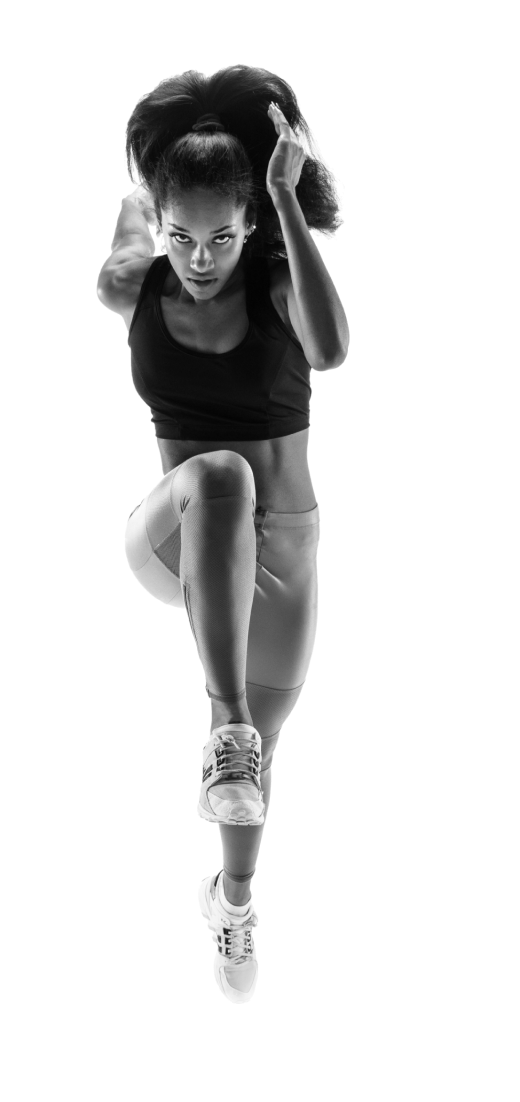 A woman in athletic wear running or leaping.