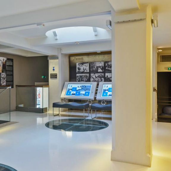 Toucan Nest digital signage software installed on interactive kiosk at museum.