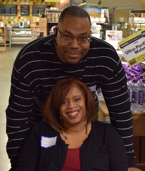 Founder Tamara Gallman and her husband are posing for a picture.