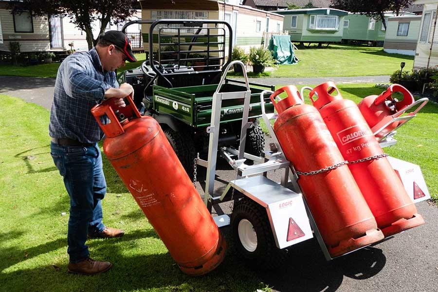 Man operating UTV  Gas Bottle Trailer GBT500