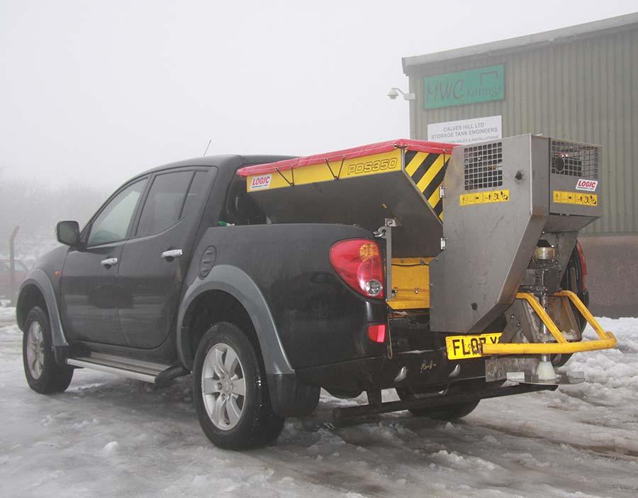 Deck Mount Powered Salt Spreader PDS354D on black pickup