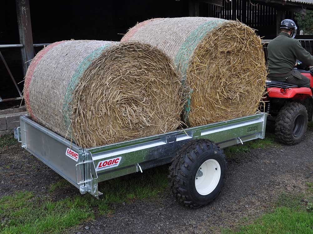 two hay bales carried by Off-Road 4X4 UTV ATV Trailer OXR