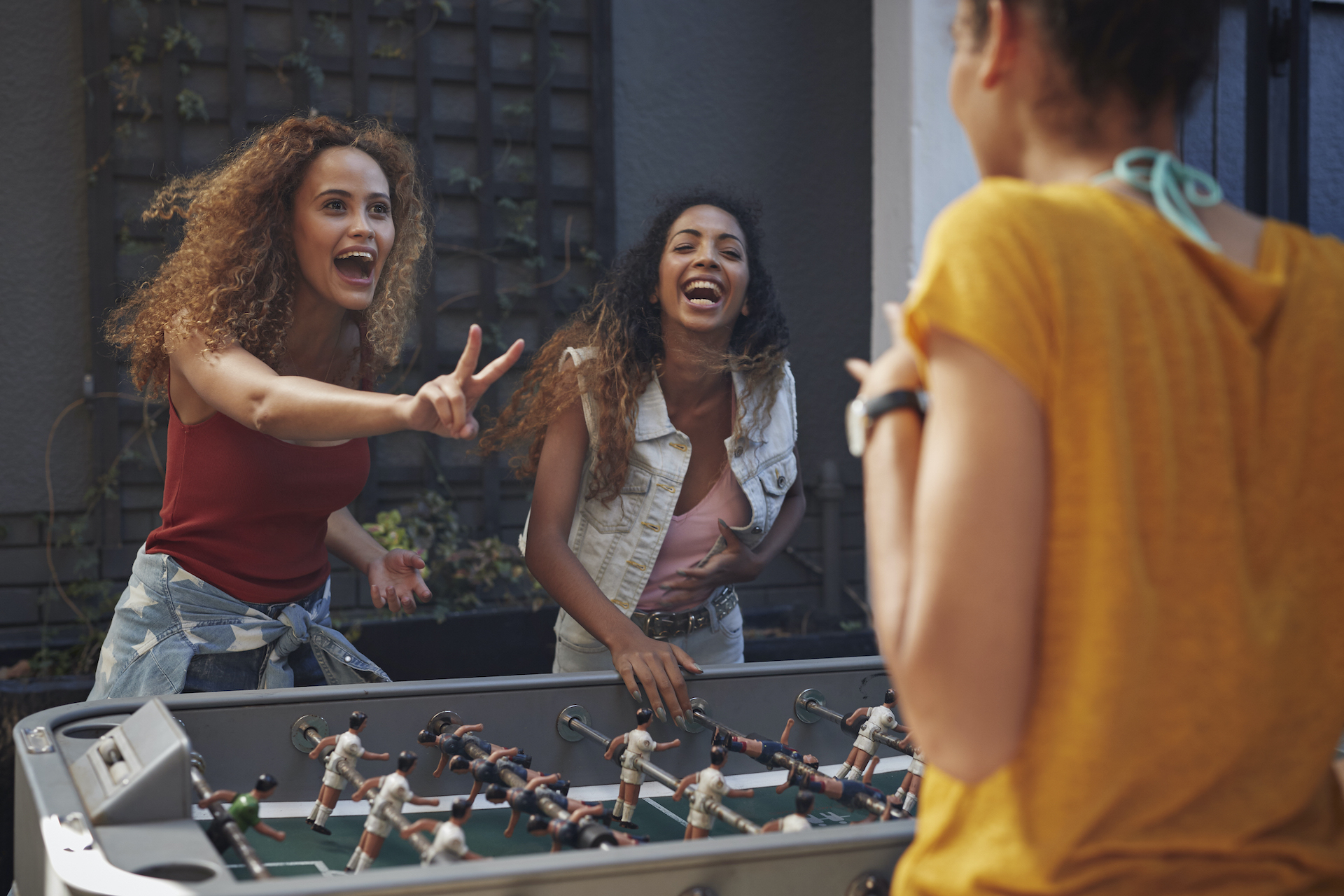 Girls playing foosball
