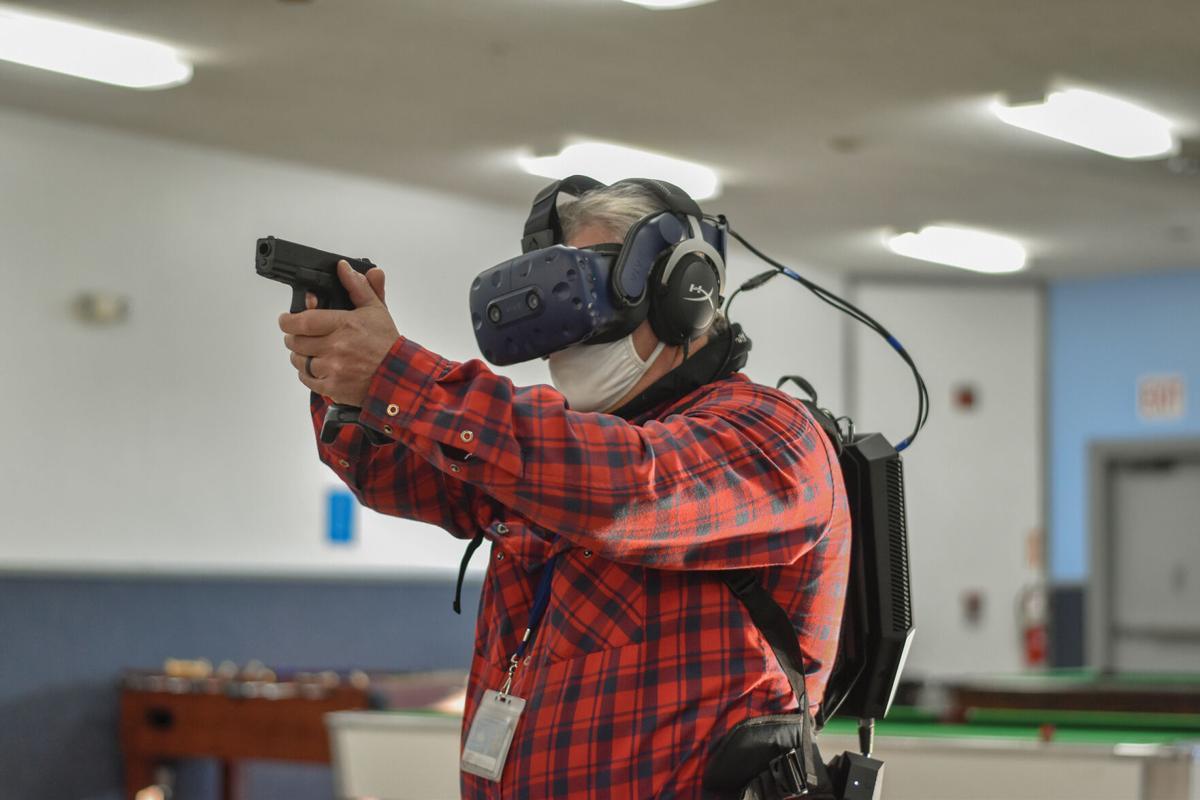 Kodiak city council member, Bob Stanford, using Kodiak Police Department's new Apex Officer training simulator.